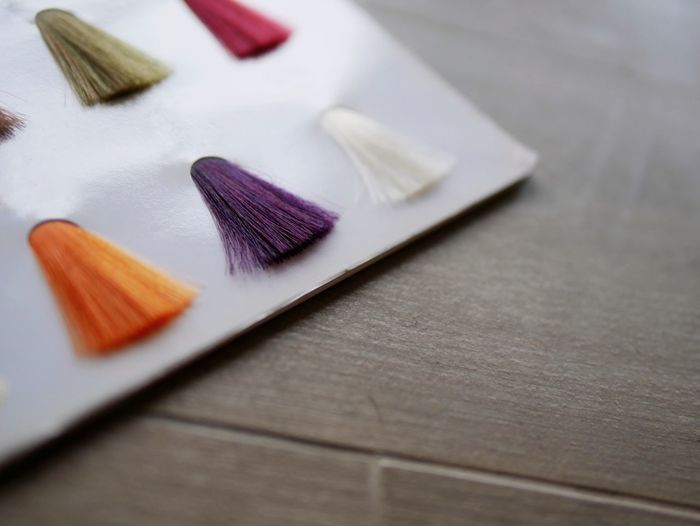 High angle view of hair color swatches on table