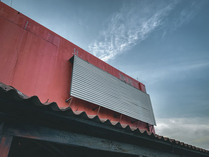 Low angle view of building roof against sky