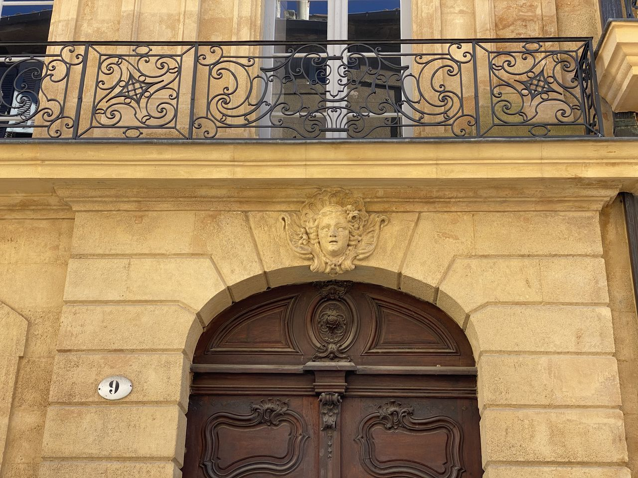 architecture, built structure, building exterior, no people, arch, low angle view, building, ornate, day, design, wall - building feature, art and craft, entrance, the past, history, pattern, wall, craft, outdoors, door, floral pattern, bas relief