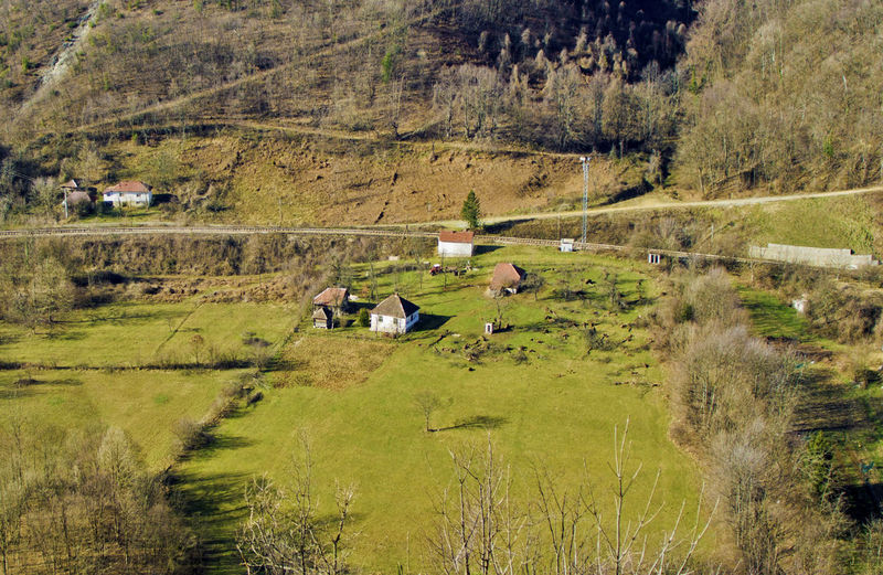 Small village near railways in rural surroundings Farm Day Environment Field Grass Land Landscape Nature No People Outdoors Plant Rural Scene