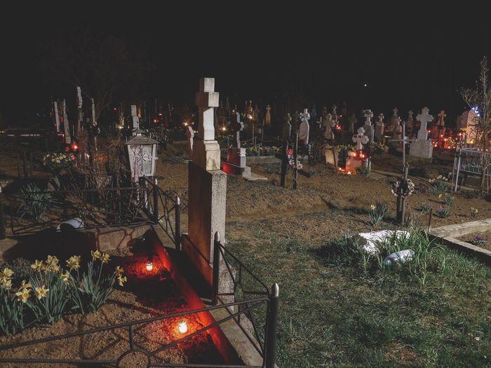Illuminated cemetery on field at night