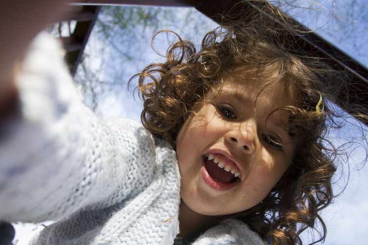 Cheerful Child Childhood Day Emotion Excitement Fun Girl Girls Hairstyle Happiness Headshot Human Body Part Innocence Leisure Activity Mouth Mouth Open One Person Outdoors Portrait Real People Smiling