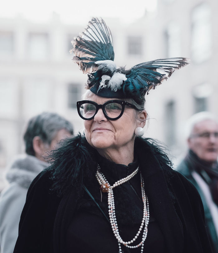 PORTRAIT OF WOMAN WITH FEATHERS IN MASK