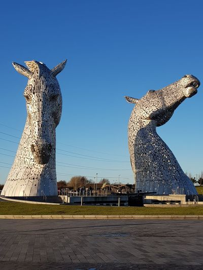 Kelpies  Kelpies Of Falkirk Monument Skulptur Heritage Scotland The Helix Travel Destinations Animal Wildlife Animals In The Wild Animal Outdoors Nature Safari Animals Mammal Clear Sky No People