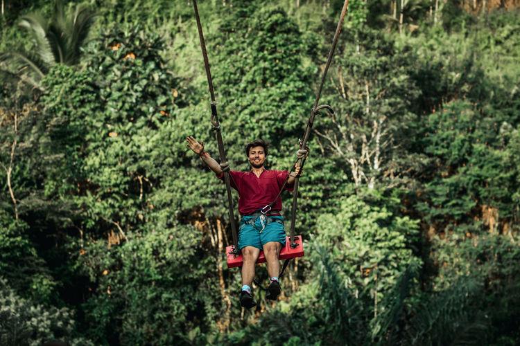 Full length of senior man in forest