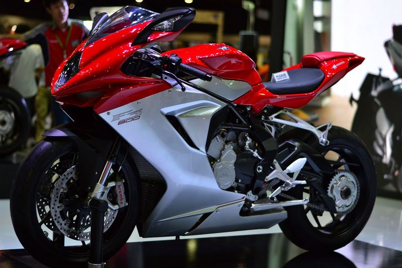 Close-up of red riding motorcycle