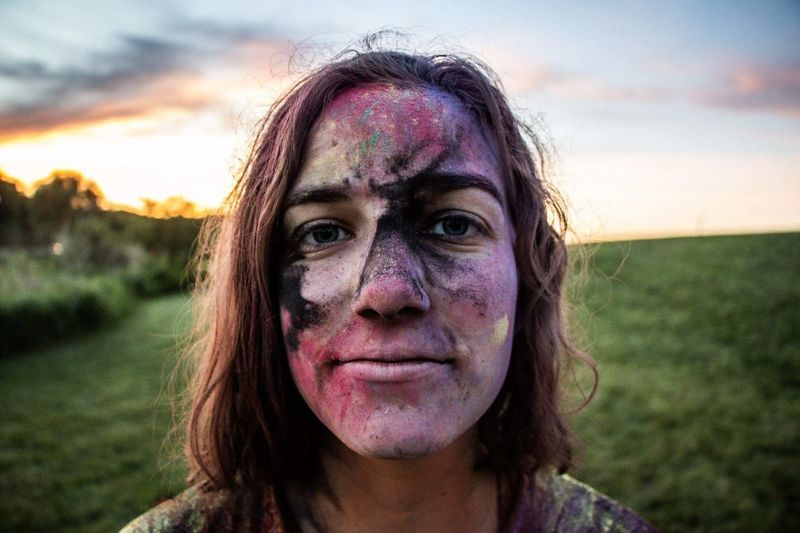 Close-up portrait of woman covered in powder paint