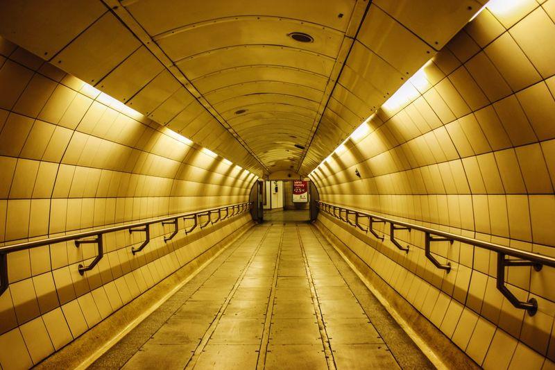 Empty Subway Along Walls