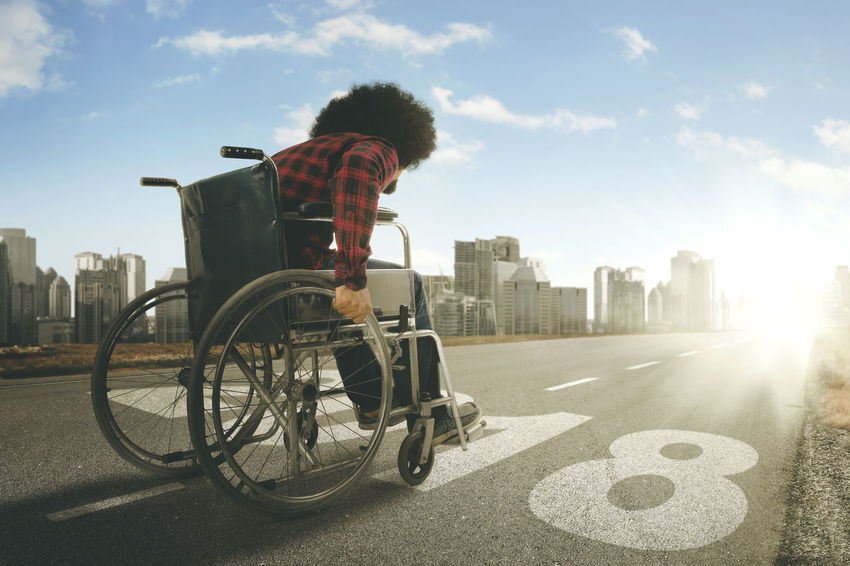 2018 Dreams Hope Adult Architecture Building Exterior Built Structure City Cityscape Day Full Length Lifestyles One Person Outdoors People Real People Road Sky Skyscraper Sunlight Wheelchair Wheelchairs Young Adult