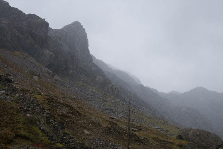 As I travelled into Snowdonia National Park and through the mountains, the weather changed to rain and fog Mountain Slope Wales Welsh Countryside Mountains Mountain Fog Hiking Steep Sky Mountain Range Landscape Weather Foggy Overcast Atmospheric Mood Rain