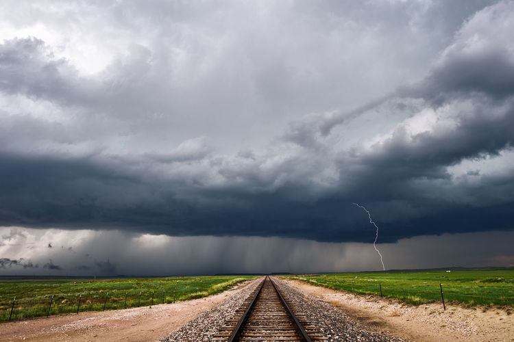 View Of Railroad Track Passing Through Field
