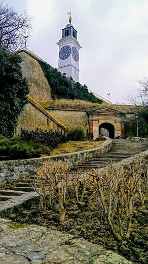 Clock tower on Petrovaradin fortress Serbia Entrance Gate Petrovaradin Fortress Clock Tower Stairs Clock Tower And History Fortress Walls Fortress In Europe Historical Place Fortress Europe Outdoor Photography No People Culture Heritage Historical Building Novi Sad, Serbia No People Architecture Outdoors Sky Building Exterior Day Built Structure