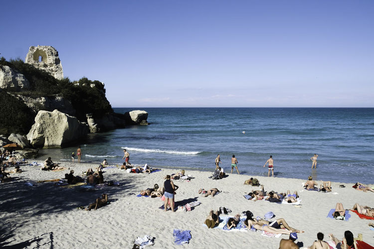 Beach Beauty In Nature Blue Clear Sky Cliff Day Horizon Over Water Italy Large Group Of People Melendugno Nature Outdoors People Puglia Real People Salento Scenics Sea Sky Summer Summertime Travel Destinations Vacations Water Women Live For The Story