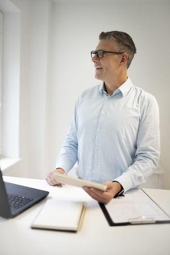 Man using laptop on table