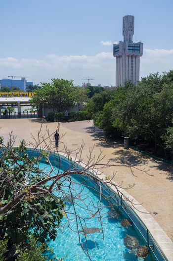 The turtle pool at the national aquarium in Havana, with the towering russian embassy in the background. Aquarium Architecture Cuba Day Havana MIRAMAR  Playa Russian Embassy Sky Tourism Travel Travel Destinations Turtles