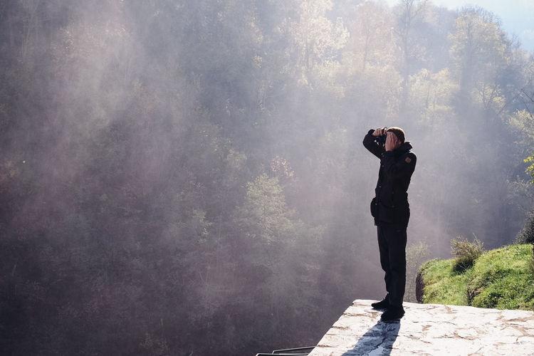 Man photographing at camera