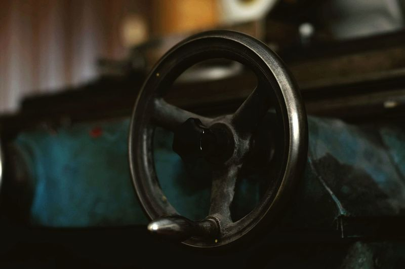 Close-up of old machine on table