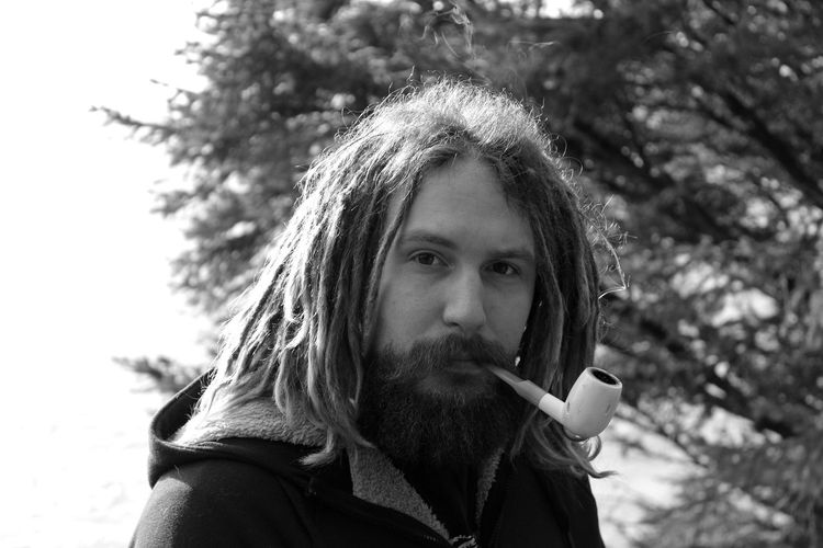 Beard Bearded Black And White Black And White Portrait Dreadlocks Head And Shoulders Headshot Lifestyles Long Hair Looking At Camera Mustache Outside Person Pipe Pipe Smoking Portrait Portrait Photography Real People