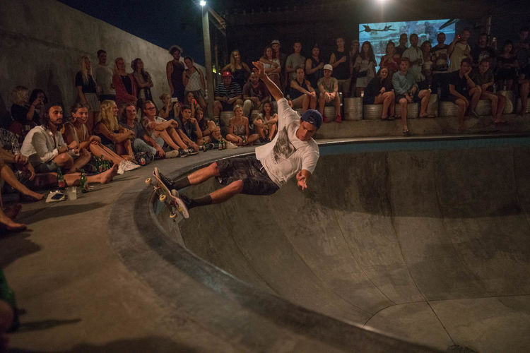 Skating in Bali Skateboarding Skatepark Adult Arts Culture And Entertainment Audience Crowd Day Empty Pool Enjoyment Full Length Indoors  Large Group Of People Leisure Activity Lifestyles Men People Performance Performing Arts Event Pool Real People Skate Skateboard Skater Skill  Youth Culture