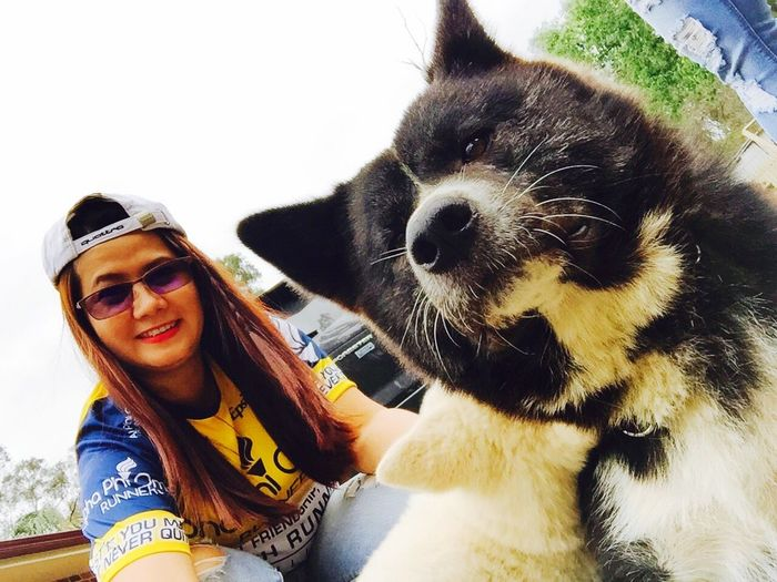 Pets One Animal Domestic Animals Dog Friendship Mammal One Person Looking At Camera Lifestyles Smiling Portrait Real People Young Adult Cheerful Japaanese Akita Noble Dog Hachiko