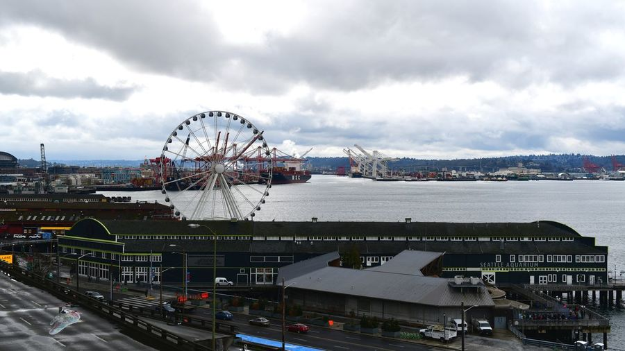 Seattle East The Street Photographer - 2019 EyeEm Awards The Great Outdoors - 2019 EyeEm Awards The Architect - 2019 EyeEm Awards City Ferris Wheel Arts Culture And Entertainment Amusement Park Amusement Park Ride Sky Building Exterior Built Structure Cloud - Sky Architecture Cityscape Settlement Skyline