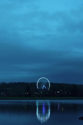 Fairground Attraction. Water Sky Cloud - Sky Reflection Nature No People Waterfront Lake Ferris Wheel Illuminated Scenics - Nature Night Outdoors Beauty In Nature Architecture Travel Destinations Ball Sphere Tranquility