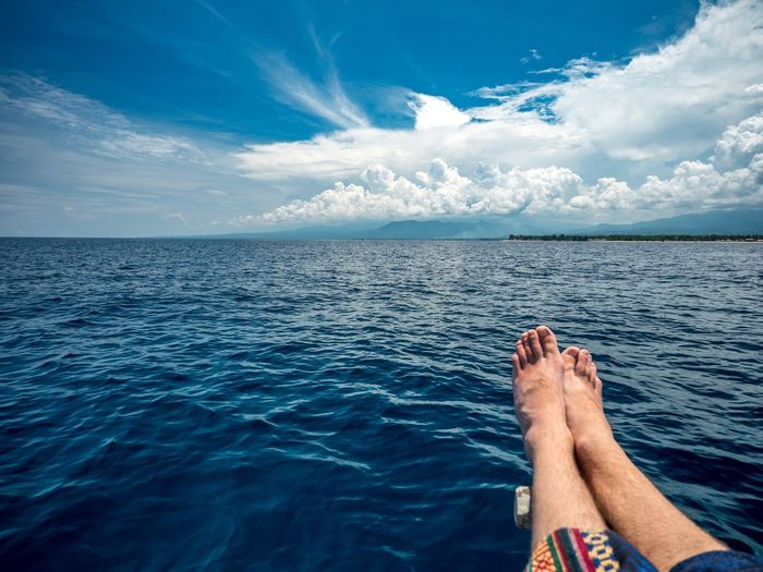 EyeEm Selects Water Sea Human Body Part Sky Body Part Low Section Human Leg barefoot Cloud - Sky One Person Horizon Over Water Nature Holiday Leisure Activity Lifestyles Relaxation Beauty In Nature