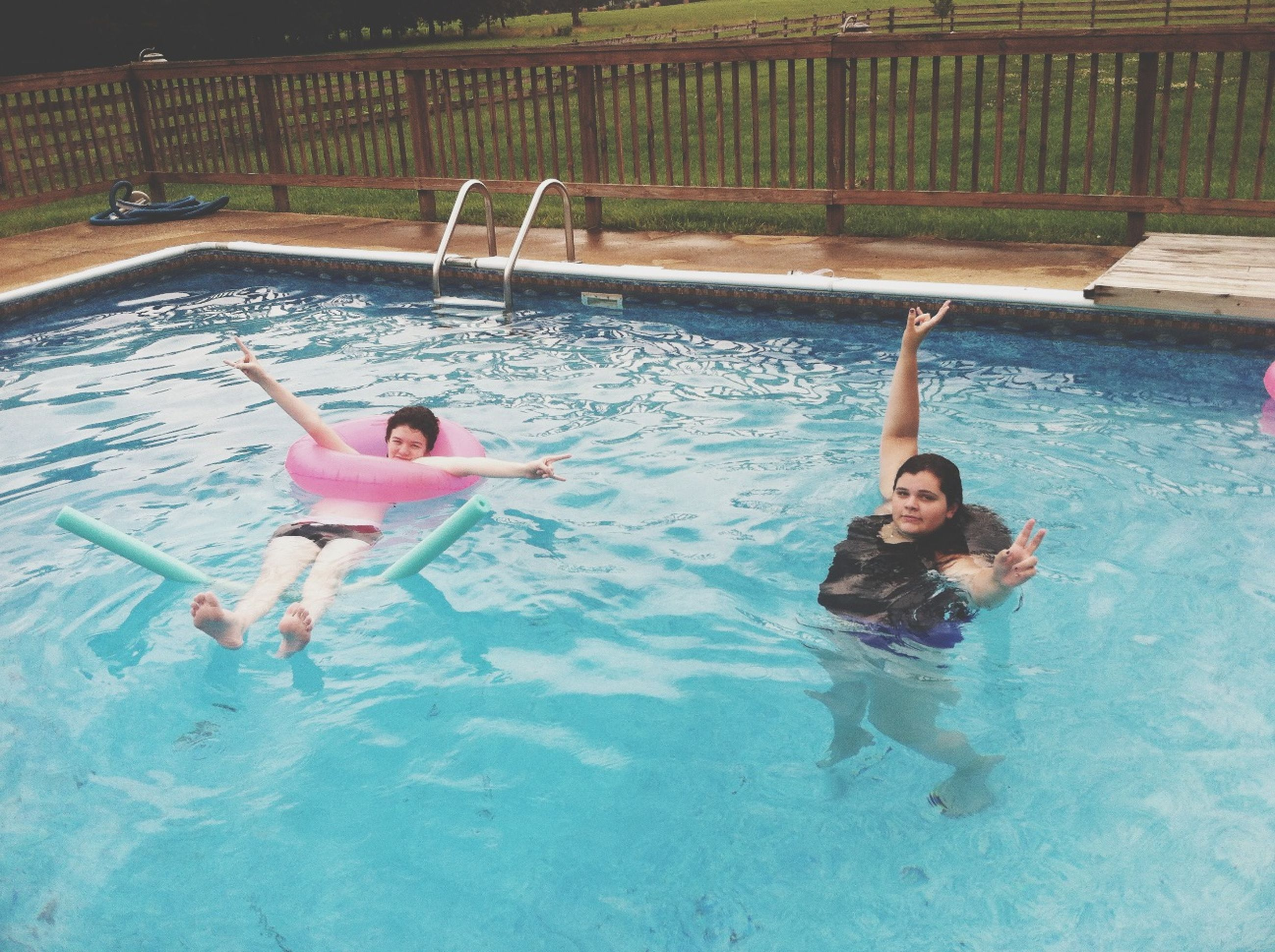 lifestyles, leisure activity, water, full length, person, young adult, enjoyment, swimming pool, shirtless, fun, childhood, vacations, young women, elementary age, high angle view, casual clothing, swimming, boys