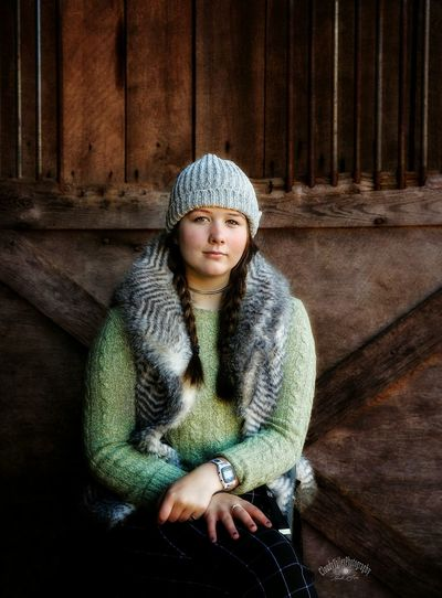 Portrait of girl wearing knit hat standing at home