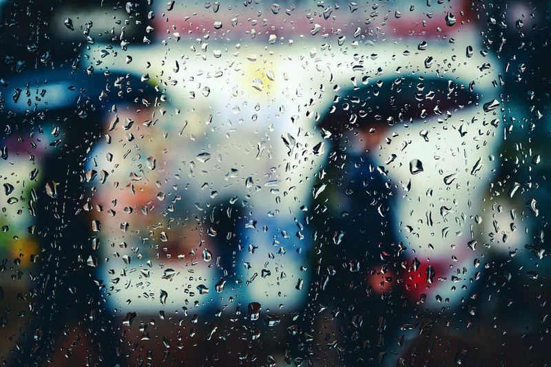 Raindrops on glass window during rainy season