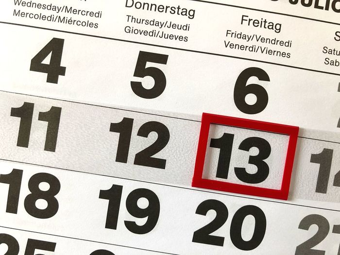 Close-up of calendar with marking on number 13