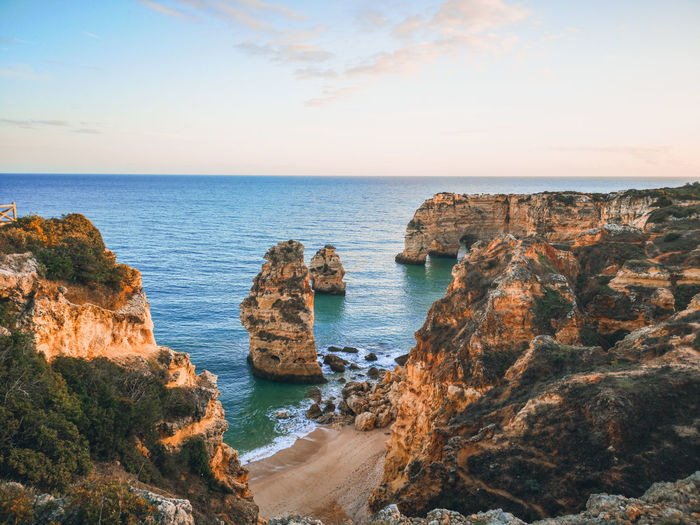 Praia da marinha Water Idyllic Idyllic Scenery Scenics Scenics - Nature EyeEm Nature Lover My Best Photo Travel Destinations Praia Da Marinha Algarve Portugal Life Is A Beach Ocean Ocean View Beach Beachphotography Beach Life Water Sea Beach Sunset Panoramic Sky Horizon Over Water Low Tide Rocky Coastline Coastal Feature Coastline Coast Seascape Stay Out The Traveler - 2019 EyeEm Awards