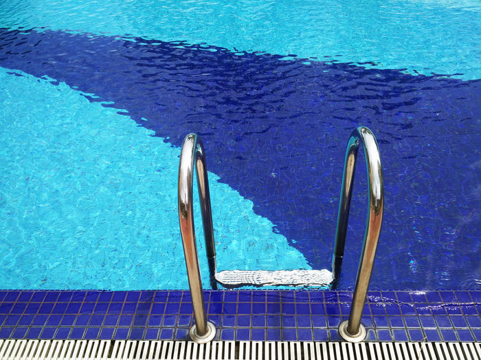 High angle view of railing in swimming pool