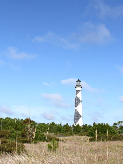 Architecture Beauty In Nature Blue Building Exterior Built Structure Cape Lookout National Seashore Cloud - Sky Day Field Grass Growth Landscape Lighthouse Nature No People North Carolina Outdoors Outer Banks, NC Protection Scenics Sky Tranquil Scene