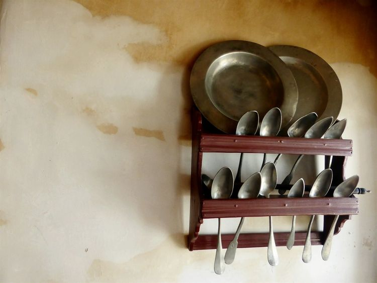 Old Times Old Things Kitchen Utensils Kitchenware Plates Spoons Hanging On The Wall Vintage Style House Detail No People