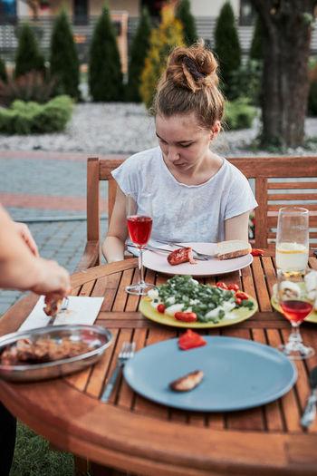 Girl sitting at restaurant outdoors