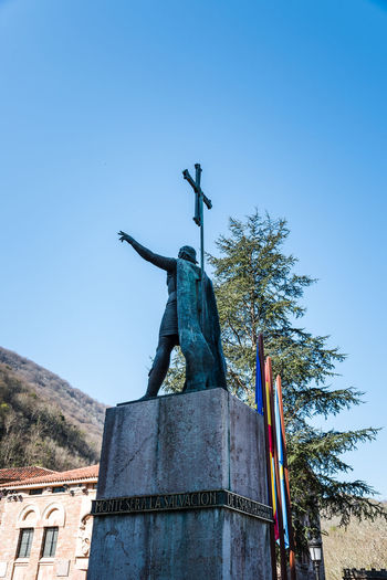 The statue of King Pelayo the first king of Spain Architecture Day No People Nature Reconquest Covadonga Asturias Asturias Paraiso Natural🌿🌼🌊🌞 SPAIN Europe Pilgrimage Basilica Landmark Pelayo  Statue Monument Sculpture Battle Of Covadonga Sky Human Representation Representation Male Likeness Art And Craft Clear Sky Blue Religion Low Angle View Creativity Spirituality Belief Angel