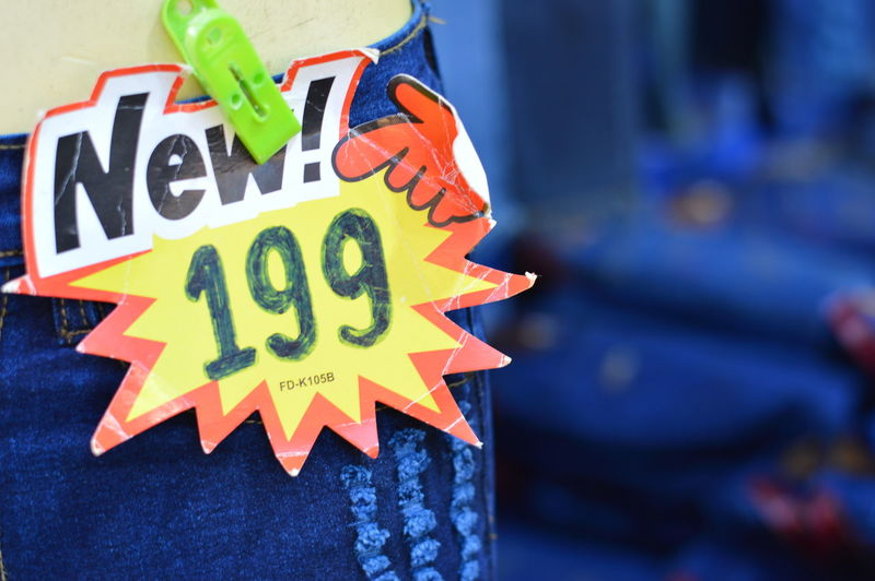 Close-up of price tag on jeans at clothing store