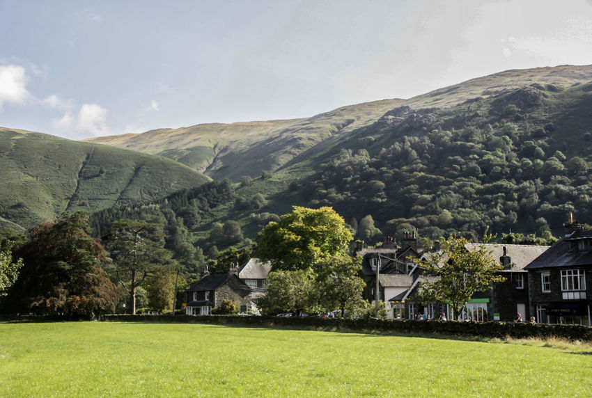 The view over to Grasmere Village EyeEmNewHere Grasmere Lake District National Park Architecture Beauty In Nature Building Exterior Built Structure Day Grass Green Color House Idyllic Landscape Mountain Mountain Range Nature No People Outdoors Scenics Sky Tranquil Scene Tree