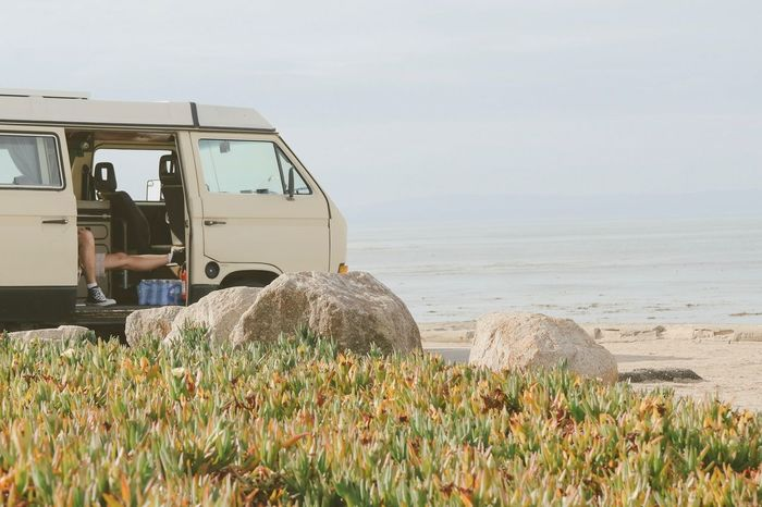 Person inside vehicle enjoying a peaceful ocean view Beach Coast Day Grass Horizon Over Water Leisure Lifestyle Looking Nature Ocean Ocean View Outdoors Peaceful Peaceful View Scenics Sea Sky Transportation Travel Vacation Vehicle