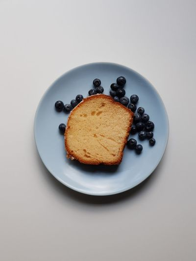 lemon cake and blueberries On The Table No People Table Fresh Products Happiness Lemon Cake Ready-to-eat Blue Plate Minimalism Peaceful Berries Coffee Break Birthday Delicious Hungry Sugar Sweet Food Kitchen At Home Light Colors Sweet Pie Plate Dessert Cake Directly Above Sweet Food Food And Drink Slice Of Cake Blueberry Food Styling