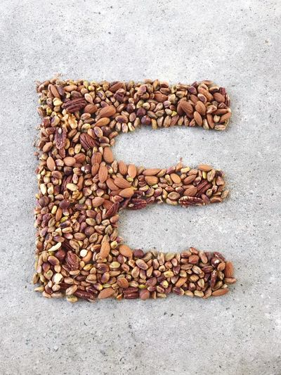Capital letter E from almonds, pistachios, hazelnuts, pecan nuts and walnuts on concrete floor Alphabet Mock Up Letter E Capital Letter Healthy Food Concept Pecan Nuts Roasted Almonds Walnuts Pistachio Variety Of Nuts High Angle View Top View Hazelnuts EyeEm Selects Food And Drink Directly Above Food Still Life Freshness No People Large Group Of Objects Abundance Wellbeing Brown High Angle View Healthy Eating Day Healthy Lifestyle Close-up Dried Food