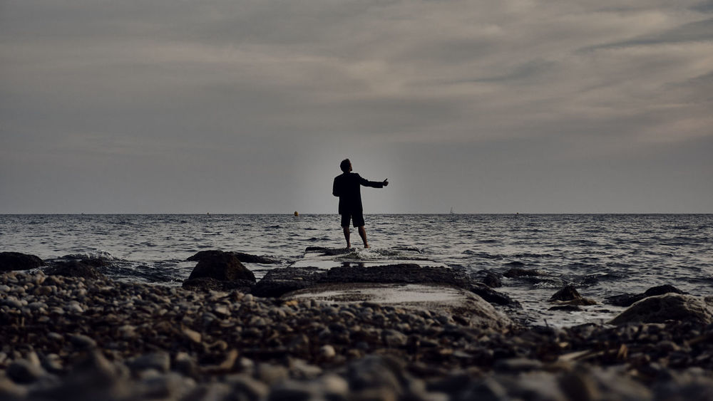 hItchhiking on the road of life Hitchhiker Hitchhiker At Sea Hitchhiking Outdoors Outside Outside Photography Rock Skipper Rock Skipping Rock Throwing Rocky Coast Sea Sea And Sky Seahiking Silhouette Silhouette At Sea Travel Travel Destinations Travel Photography Traveling