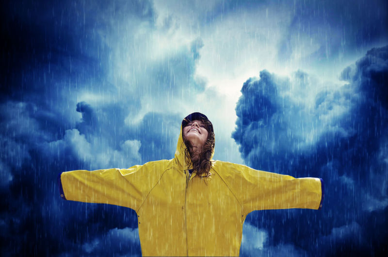 Young woman in the rain Yellow Arms Outstretched Arms Raised Digital Composite Rain Outdoors Girl Woman Weather Storm Happy Rainy Clouds Thunderstorm Health Weather Forecast Nature Vitality Cheerful Raincoat Rain Jacket Smile Season  Beauty Young Adult