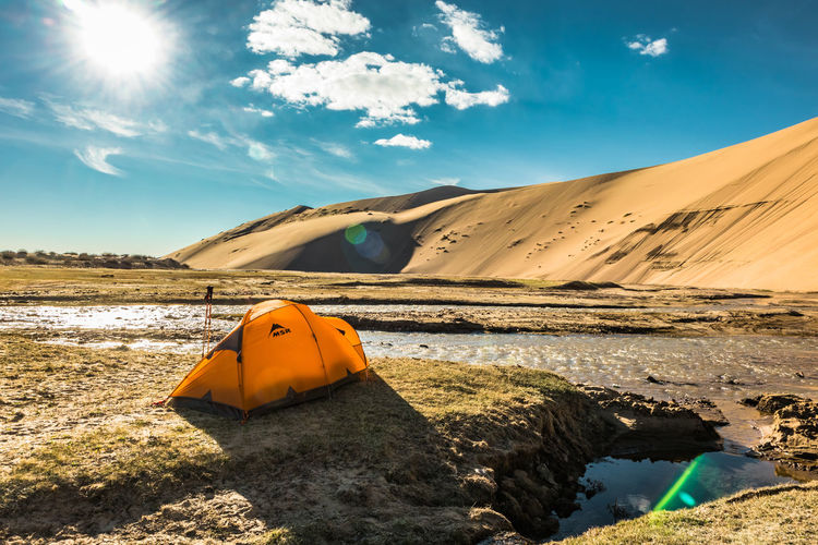 Mongolia Sky Scenics - Nature Beauty In Nature Nature Sunlight Land Cloud - Sky Tranquil Scene Tranquility Water Orange Color Beach Day Non-urban Scene Sand Rock Solid Rock - Object No People Outdoors Arid Climate Climate The Traveler - 2019 EyeEm Awards