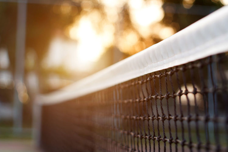 Close-up of metal fence against building