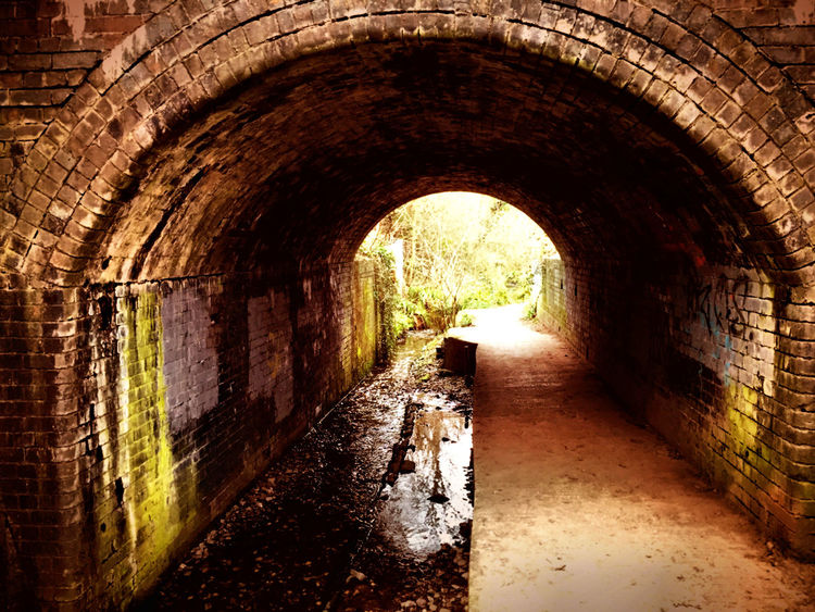 Abandoned Arch Arched Architecture Archway Brick Wall Building Building Exterior Built Structure Diminishing Perspective History Indoors  Narrow Old Old Ruin Stone Wall The Way Forward Tunnel Wall Wall - Building Feature