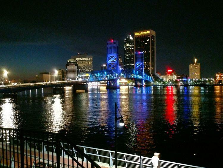 Jacksonville FL at night Tranquil Skyline At Night Water Illuminated Skyscraper Modern Nightlife River