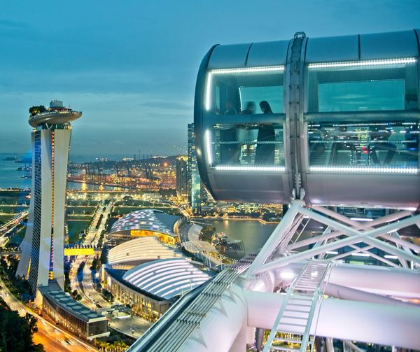 Singapore Flyer and Marina Bay Sands Hotel Building Exterior Sky Architecture Industry City Built Structure Nature Cityscape No People Factory High Angle View Outdoors Oil Industry Technology Refinery Metal Travel Destinations Day Complexity Pollution Singapore Flyer Marina Bay Sands Singapore