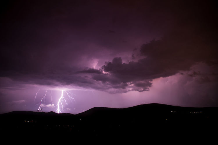 Lightning Strike At Silhouette Landscape